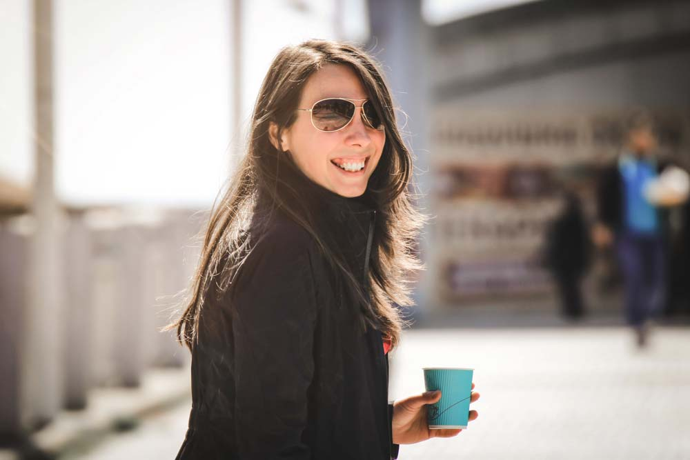 smiling-woman-is-drinking-a-coffee