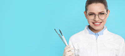 Female,Dentist,Holding,Professional,Tools,On,Color,Background.,Space,For